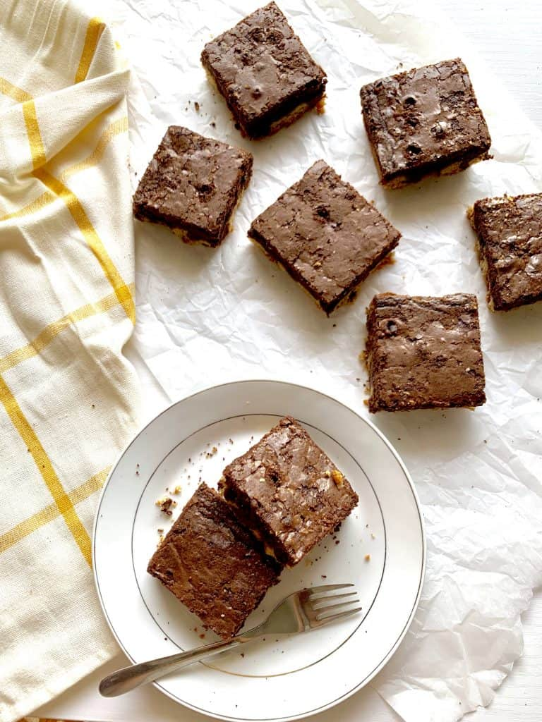Cookie brownie bars, cut and served on plate
