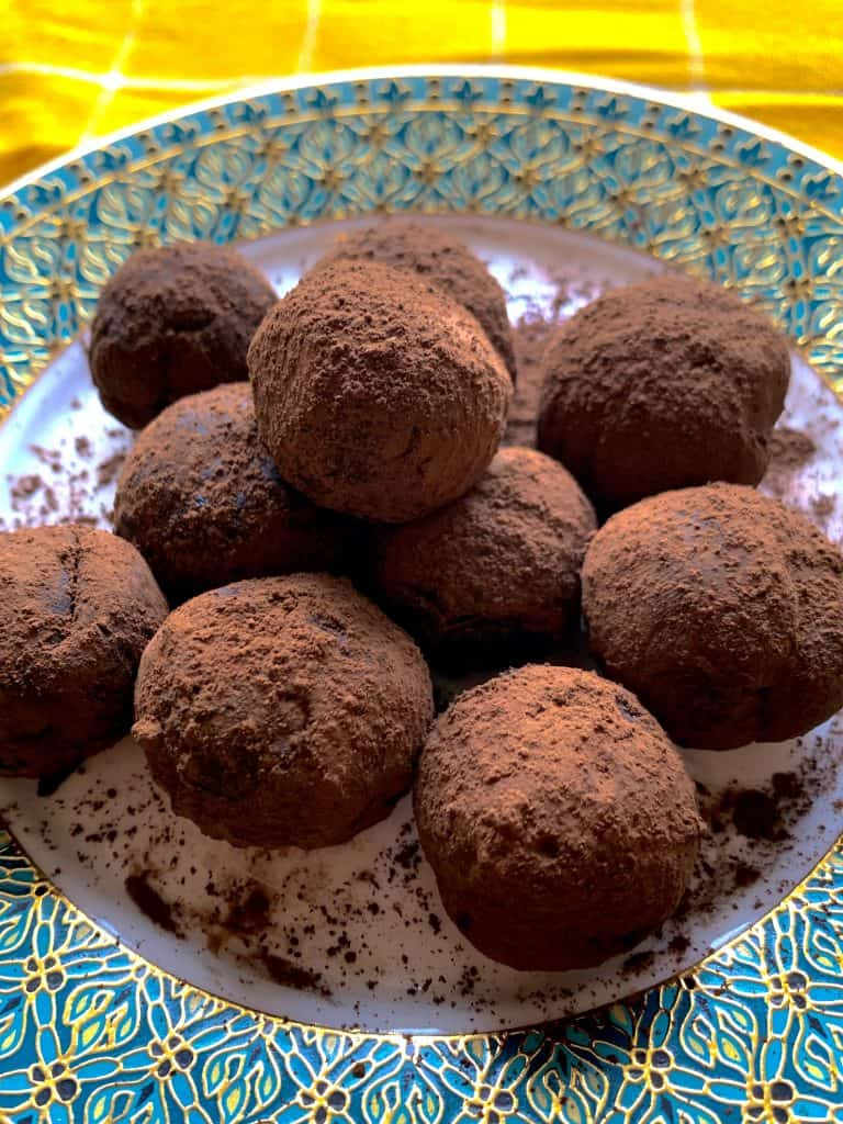 DARK CHOCOLATE TRUFFLES ON A TURQUOISE PLATE