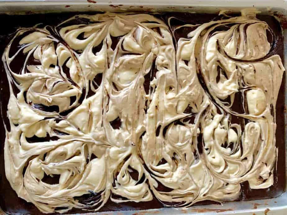coffee cheesecake brownie batter in the tray