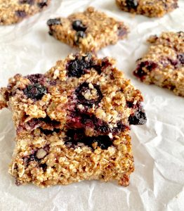 blueberry oat bars on parchment sheet